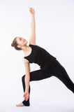 Advanced yoga posture, demonstrated by bloden girl, dressed in black, on white background stock photos