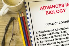 Advances in Biology Science concept. With topics on a cover sheet Stock Photos