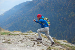 Advanture man with backpack hiking Royalty Free Stock Photos