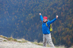 Advanture man with backpack hiking Stock Photography