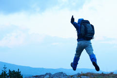 Advanture man with backpack hiking Royalty Free Stock Image