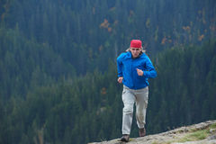Advanture man with backpack hiking Stock Photo