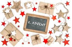 Advenimiento envuelto de la pizarra de la decoración de la Navidad de los regalos Imagen de archivo