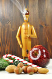 Advent. German Smoker with nuts, apple and candy cane Royalty Free Stock Photos