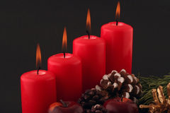Advent. Red candels and still life on a black background Royalty Free Stock Photography