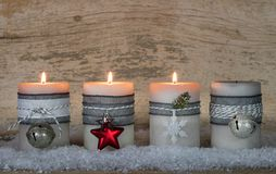 Advent. Season with traditional burning Christmas candle flames Royalty Free Stock Photography