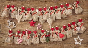 Advent calendar. On wooden background Stock Photo