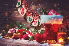 Advent Calendar And Santa`s Shoe With Gifts On Rustic Wooden Bac Stock Photo