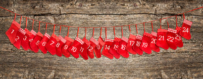 Advent calendar banner. Red christmas stocking wooden background Stock Photos