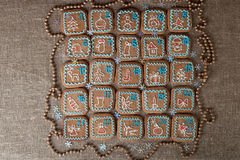 Advent calendar, Christmas handmade gingerbread painted icing. On a linen background Royalty Free Stock Photography