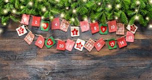 Advent calendar Christmas tree branches light garland royalty free stock photography