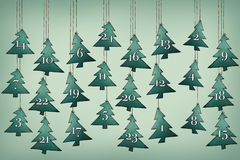 Advent Calendar with christmas trees. Illustration of an advent calendar with hanging christmas trees Royalty Free Stock Images