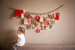 The advent calendar hanging on the wall. small gifts surprises for children.  royalty free stock photo