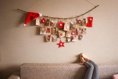 The advent calendar hanging on the wall. small gifts surprises for children royalty free stock photography