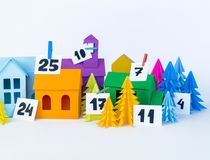 Advent calendar for kids rainbow color. House and Christmas tree paper craft. Advent calendar for baby rainbow color. House and Christmas tree paper craft stock photography