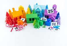 Advent calendar for kids rainbow color. House and Christmas tree paper craft. Advent calendar for baby rainbow color. House and Christmas tree paper craft stock image