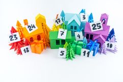 Advent calendar for kids rainbow color. House and Christmas tree paper craft. Advent calendar for baby rainbow color. House and Christmas tree paper craft stock photo
