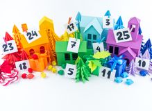 Advent calendar for kids rainbow color. House and Christmas tree paper craft. Advent calendar for baby rainbow color. House and Christmas tree paper craft royalty free stock photo