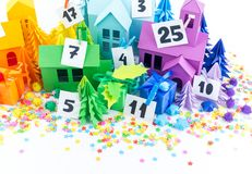 Advent calendar for kids rainbow color. House and Christmas tree paper craft. Advent calendar for baby rainbow color. House and Christmas tree paper craft royalty free stock images