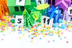 Advent calendar for kids rainbow color. House and Christmas tree paper craft. Advent calendar for baby rainbow color. House and Christmas tree paper craft royalty free stock photos