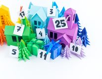 Advent calendar for kids rainbow color. House and Christmas tree paper craft. Copy space. Advent calendar for baby rainbow color. House and Christmas tree paper stock photography