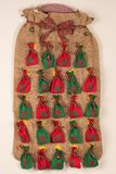 An advent calendar made of one big and small red, green bags Royalty Free Stock Images