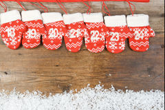 Advent calendar with mittens on wooden background Stock Photo