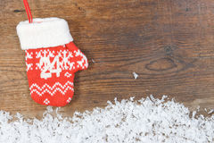 Advent calendar with mittens on wooden background Stock Photography