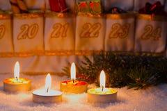 Advent Calendar por luz de una vela Imagen de archivo