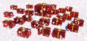 Advent calendar. Presents in red gift wrap paper as advent calendar in the snow Stock Photo