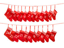 Advent calendar 1-24. Red christmas stocking gift bags decoratio Stock Image