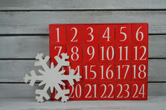 Advent calendar and snowflake Stock Photo