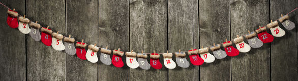 Advent calendar on wooden background royalty free stock images