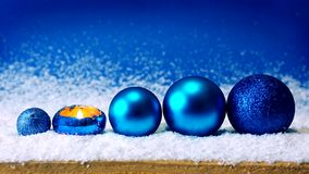 Advent candle and blue Christmas balls . stock video footage