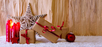 Advent candle and Christmas star. Royalty Free Stock Photo