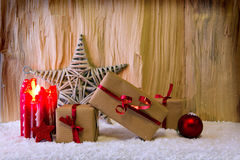 Advent candle and Christmas star. Stock Photos