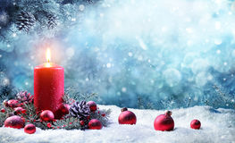 Advent Candle With Fir Branches Burning. In Snowy Scene Royalty Free Stock Photos