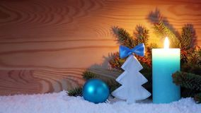 Advent candle and wood fir tree . Christmas background. Christmas background with blue Advent candle ,fir tree and white snow stock footage