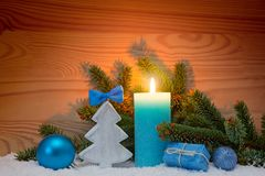 Advent candle and wood fir tree . Christmas background. Stock Photos