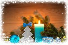 Advent candle and wood fir tree . Christmas background. Stock Image