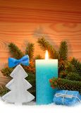 Advent candle and wood fir tree . Christmas background. Royalty Free Stock Photos