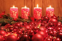 Advent candles and Christmas balls Stock Photos