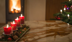 Advent candles with Christmas tree and burning chimney fire Stock Images