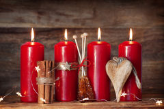 Advent candles with cinnamon and candy Royalty Free Stock Photography