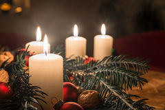 Advent candles with decorated fir tree on a ancient table Stock Photos