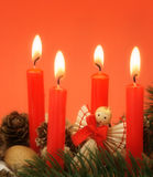 Holiday candles. Advent candles with decoration and small straw angel Royalty Free Stock Image