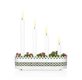 Advent candlestick with all four candles lit. Stock Photos