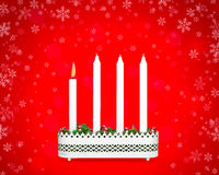 Advent candlestick with one burning candle. Advent candlestick first Sunday of Advent on red background with snowflakes Royalty Free Stock Image