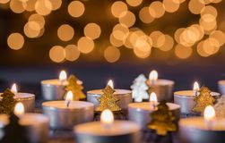 Advent and christmas background with candlelight, blurred lights and ornaments royalty free stock images