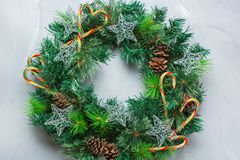 Advent christmas door wreath with festive decoration. Holidays new year concept. Advent christmas door wreath with festive decoration on a cozy background. Flat royalty free stock photography